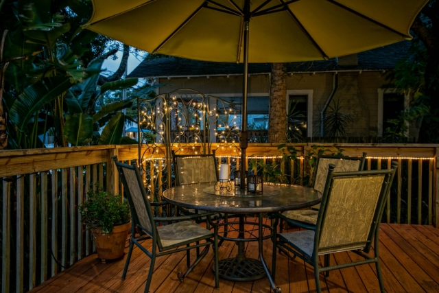 anchor inn bnb patio umbrella and glass table night