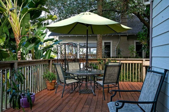 anchor inn bnb patio umbrella and glass table alternate